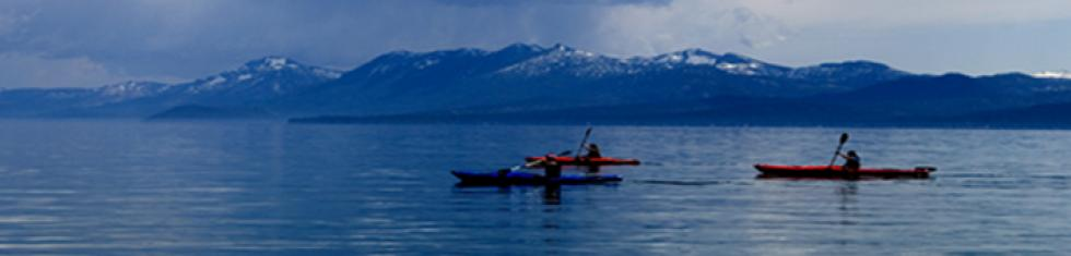 3 kayakers on Lake Tahoe, cloudy day
