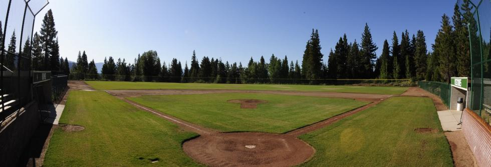 Ballfield with beautiful blue sky and trees